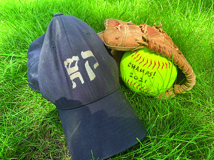 Here's the game ball from Congregation Shir Tikvah's playoff championship win, with player Herschel Poger's mitt and team cap.