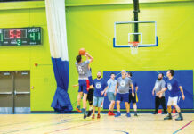 Steven Hertzberg puts up a shot during a Jewish Men's Basketball League game in 2019.
