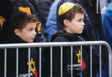 Children attend a rally Nov. 9, 2018, in Pittsburgh for peace and unity to remember victims of the Tree of Life synagogue shooting 13 days earlier,