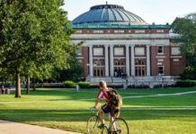 A student bikes across campus at the University of Illinois at Urbana-Champaign.